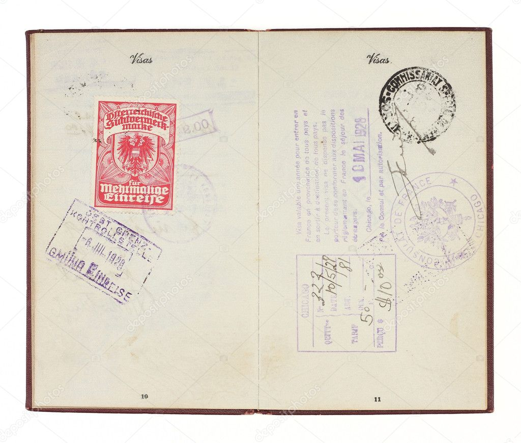 A U.S. Passport from the 1920s open to two facing pages with customs stamps from 1928 Germany and France. Isolated on white with clipping path. — Stock Photo #3679972