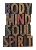 Body, mind, soul, spirit in wood type — Stock Photo