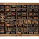 Alphabet in antique wood types — Stock Photo
