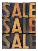 Sale concept - vintage wood types — Stock Photo