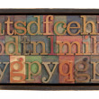 Alphabet in rustic wooden box — Stock Photo