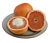 Grapefruit served with sugar — Stock Photo
