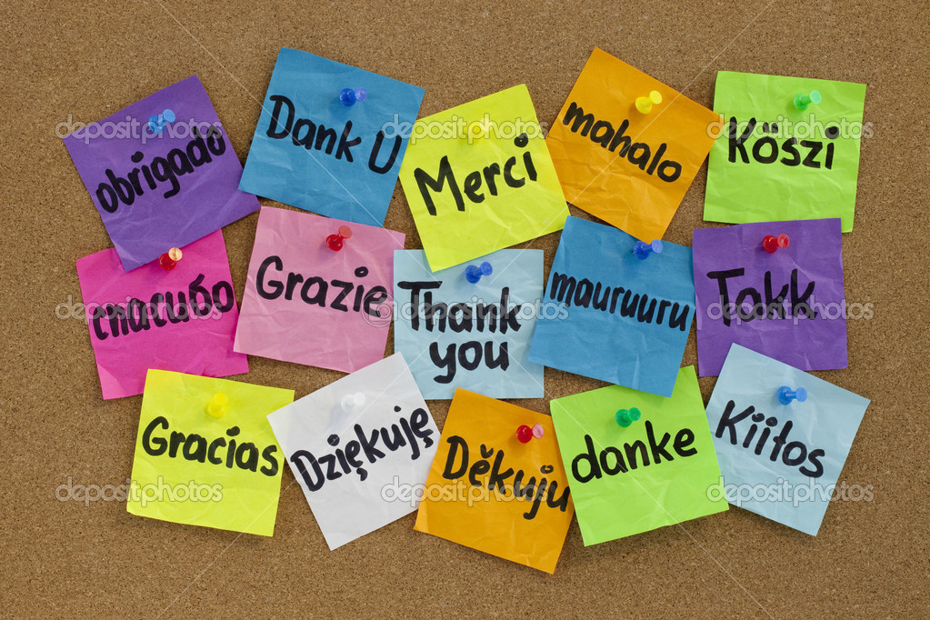 Thank you in sixteen languages - colorful sticky notes with handwriting on cork bulletin board — Stock Photo #3475594