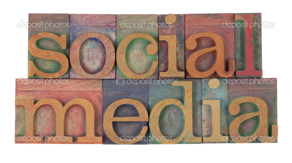 Social media in vintage wooden letterpress printing blocks, stained by color inks, isolated on white — Stock Photo #3548683