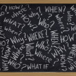 Questions on blackboard - Stok fotoğraf