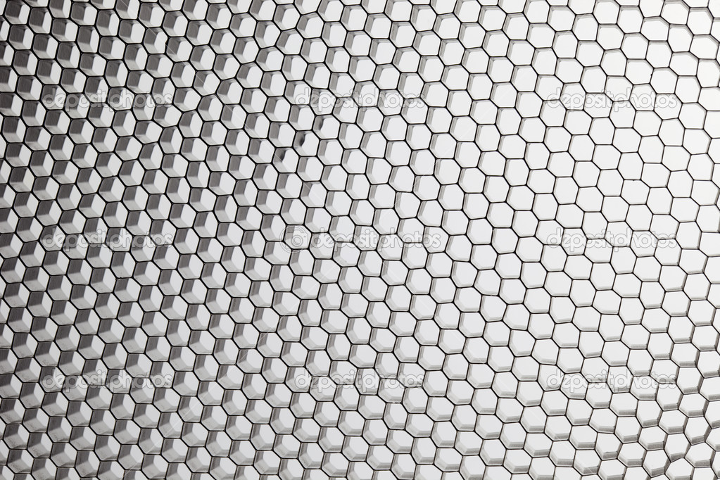 Black, metal honeycomb grid on white abstract background — Stock Photo #3654722