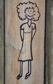 Scribble of a girl on playground wall — Stock Photo
