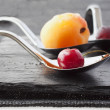 Fruit on spoons — Stock Photo