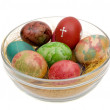 Stock Photo: Easter varicoloured eggs on glass
