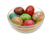 Easter varicoloured eggs on a glass — Stock Photo
