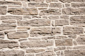 Old stone wall restored — Stock Photo