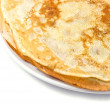 Fresh pancakes on a white plate - Stock Photo