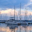 Boats and yachts moored in harbour - Stock Photo