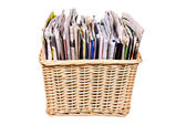 Basket with magazines — Stock Photo