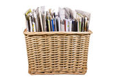 Basket with newspapers — Stock Photo