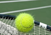 Electrified yellow tennis ball — Foto Stock