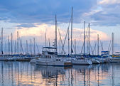 Boats and yachts moored in harbour — Stock Photo