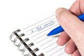 Writing down a job search plan — Stock Photo