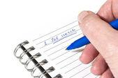 Writing down a job search plan — Stock Photo