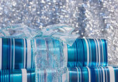 Blue glossy gift boxes with a bow — Stock Photo