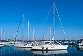Luxury white yachts and boats moored in harbour — Stock Photo