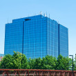 Blue modern office building with antennas - Stock Photo