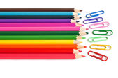 Color pencils and paper clips, office stationery — Stock Photo