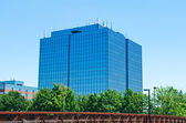 Blue modern office building with antennas — Stock Photo
