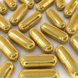 Stock Photo: Gold pill capsule