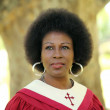 Black woman in red church robes — Stock Photo #3081683