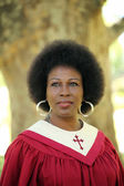 Black woman in red church robes — Stock Photo