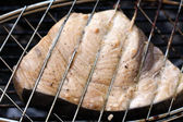 Swordfish steak cooking on barbecue grill closeup — Stock Photo