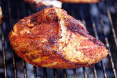 Barbecue chicken breast on grill closeup cooking — Stock Photo