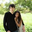 Young teen couple holding each other outdoors portrait — Stock Photo #3514301