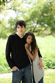 Young teen couple holding each other outdoors portrait — Stock Photo