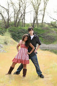 Teen boy and girl coupe outdoors striking a pose — Stock Photo