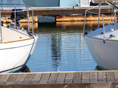 Two sailboats in berths at the marina — Stock Photo