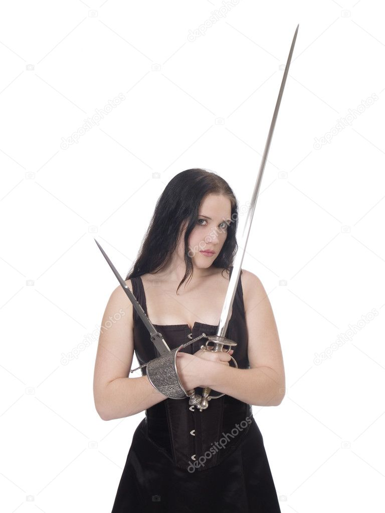 Young woman in black corset and skirt with sword and dagger — Stock Photo #3514339