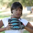 Stock Photo: Young black woman with baseball glove outdoors