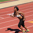 Young African American Woman Running on Track — Stock Photo
