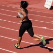Young plump black woman running on track — Stock Photo