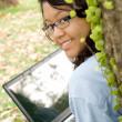 Asian female college student with laptop — Stock Photo