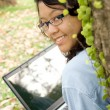 Asian female college student with laptop — Stock Photo #3819497