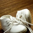 Royalty-Free Stock Photo: Worn white baby shoes