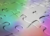 Regenboog gekleurde jigsaw puzzle — Stockfoto