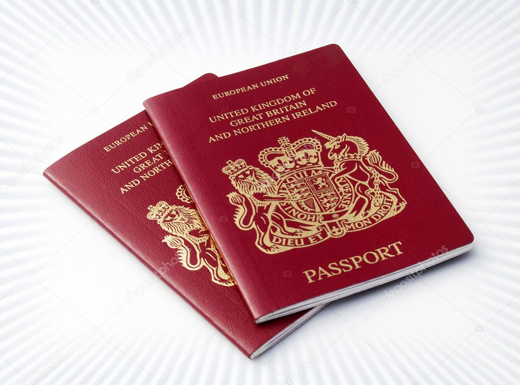 Two UK passports over circular stripe pattern  Stock Photo #3194388