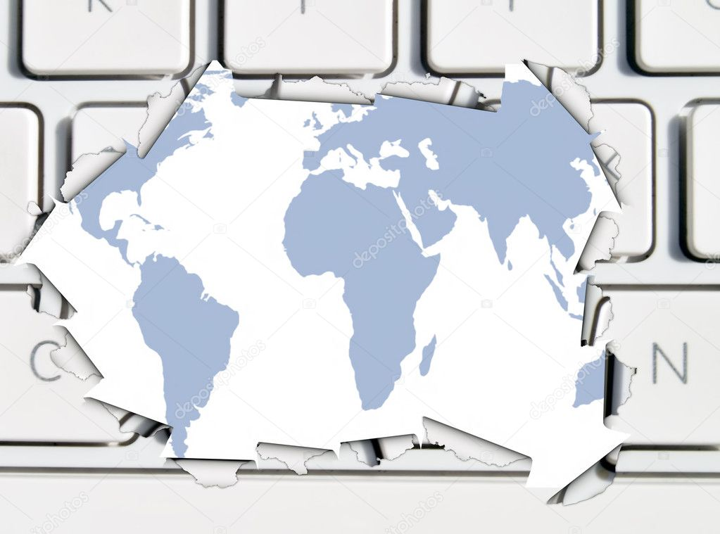 Conceptual image showing torn keyboard revealling map of world — Stock Photo #3394664