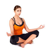 Fit Woman Practicing Sukhasana Yoga Pose — Stock Photo