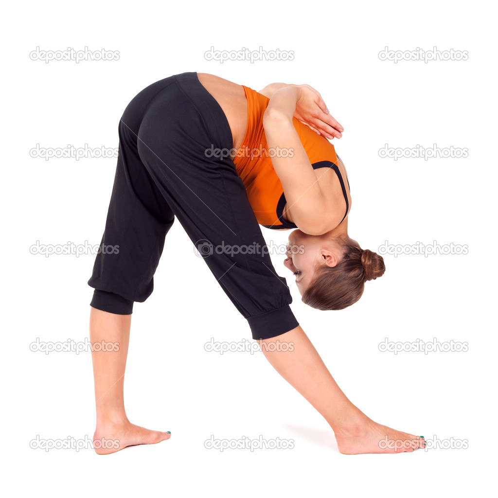 Woman doing yoga exercise called: Intense Side Stretch Pose, sanskrit name: Parsvottanasana, this posture stretches legs, shoulders and muscles in the lower bac  Stock Photo #3831566