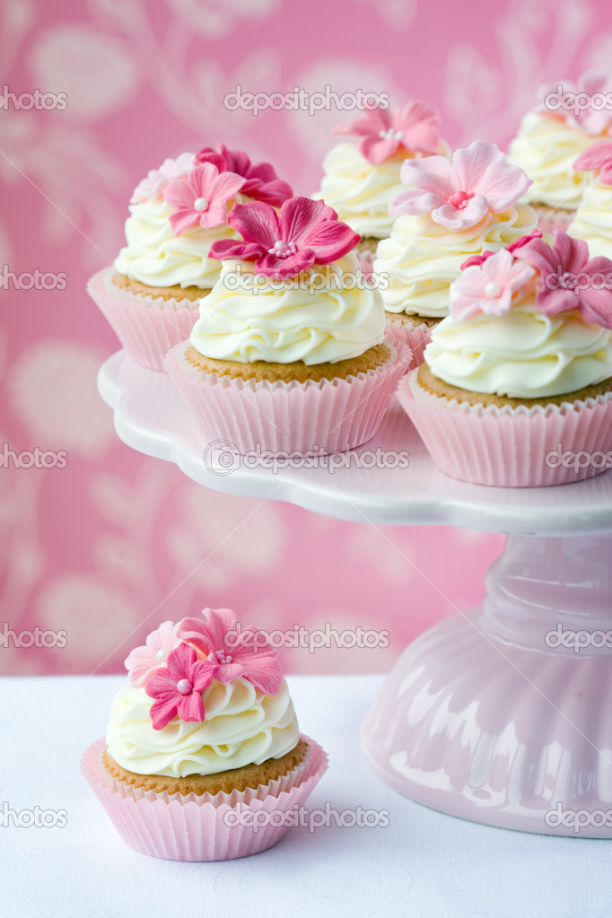 Pink flower cupcakes on a cakestand  Stock Photo #2712752